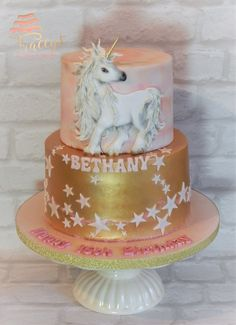 Unicorn cake with gold and watercolour effect. Bas relief, hand painted