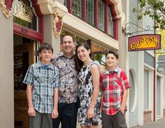 Rick and the kids in front of the new San Rafael store