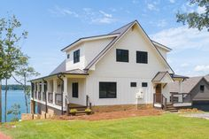 Exclusive Show-Stopping Vacation Home Plan with 3-Sided Wraparound Porch - 18302BE | Architectural Designs - House Plans Barn Homes Floor Plans, Lake House Plans, Mountain House Plans, Dream House Plans, Custom Home Plans, Home Design Plans, Porch Plans, Open Space Living, Home Fireplace