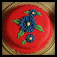 I had fun making this Gerbera daisy fondant cake.  I learned how to make it in my Wilton Method Class Course 4 at Michaels in League City, TX.  #wiltoncontest
