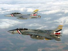 Grumman F-14 Tomcat shadowed by its replacement, the F/A-18F Super Hornet or as it is known by the aviators...Rhino