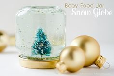 Have a bunch of baby food jars hanging around? Turn them into mini snow globes with a few household items. Baby Food Jar Snow Globes are easy to create and make a fantastic gift idea! Baby Food Jar Crafts, Baby Food Jars, Crafts For Kids, Christmas Jars, Easy Christmas Crafts, White Christmas, Miniature Christmas, Handmade Christmas, Christmas Time