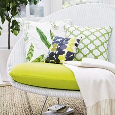 Scatter a Lloyd loom sofa from  Vincent Sheppard http://www.vincentsheppard.com with zingy cushions.