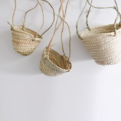 Cozy up your space with these unique handmade hanging baskets. Available in two sizes, great for hanging plants in front of windows or for outdoor living spaces. - Palm leaf hanging baskets with twist