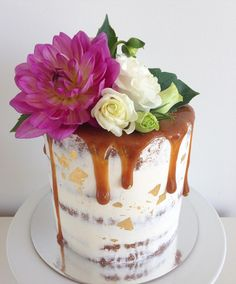 Naked cake with salted caramel drip and fresh flowers