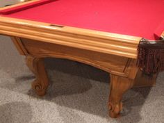 8' Regulation, 3 pc slate pool table, leather pocket; all accessories with an assortment of sticks