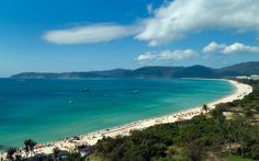 Best Beaches in Asia: Yalong Bay, Sanya, China 15 of 16   This mile-long beach, in the popular Chinese retreat of Sanya, has yet to be truly discovered by foreign visitors. To avoid crowds, skip the Christmas holidays and February, where families come for some warm-weather respite during Chinese New Year. You'll find incredible views, water activities from kayaking to jet skis, and fresh food, fruit, and juices from local vendors. The St. Regis here is an ideal home base.