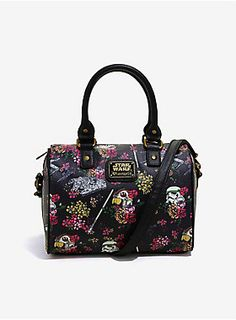 """<p class=""""MsoNormal""""><span style=""""font-family: """"Times New Roman"""", serif;"""">Fierce and floral. Feminine and fearsome. Show off your flirty side and your use of The Force with this floral<i>Star Wars</i>themed handbag! This black faux leather barrel bag has an allover floral and<i>Star Wars</i>print that features Stormtrooper and Rebel helmets, Imperial and Rebellion ships, and lightsabers. Inside the zipper closure are a drop and zipper pocket. Gold tone hardware"""