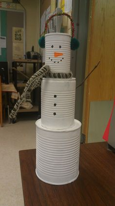 """12"""" inch snowman made from tin cans"""