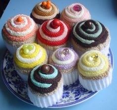 Knitted food, and especially knitted cupcakes are so great! And the other fun thing you can do with these types of things? If you make them big enough, you can take a plastic film canister, fill it with little bells or something similar, and then sew it into the cupcake to add a nice jingly noise for a baby.