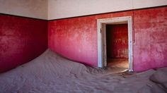 The installation is the work of Australian photographer Emma McEvoy, who is using the space to show images taken during a trip to Kolmanskop, a town in Nambia that has been relinquished to the desert.