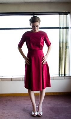 Cranberry, cotton spandex blend dress with pleats on the skirt.