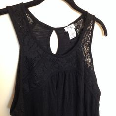 Sleeveless, lace neckline shirt 1 1/2 inch strap sleeveless tank top with lace detail on neckline and flowy Tobi Tops Tank Tops