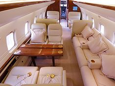 Inside of private jet. Gold, wood, and cream interior couldn't get any lovelier. Luxury Jets, Luxury Private Jets, Private Plane, Cabin Curtains, Private Jet Interior, Curtain Divider, Challenger Aircraft, Aircraft Interiors, Media Table