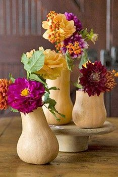 PUMPKIN AND GOURD VASES  Sculpt pumpkins and squashes into vases for your festive floral arrangements. Cut out the tops with a sharp knife and hollow out the insides for inexpensive, shapely vases