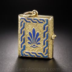 Antique Book Locket   A 15K Yellow gold (hence British) Victorian book motif locket with beautiful blue enameling and engraving on the front and floral and scroll motifs on the reverse. You won't be able to put it down! This very lovely and unusual locket measures about 1 inch tall by 3/4 inch wide.