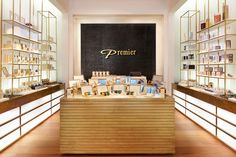 Inspiration for the store's design was drawn from the Parisian pharmacies of the 1920's, combined with elements of art deco. This can be seen in the various brass pieces: the slim geometric embellishments, the prominent color pallet (gold, black and white) and in the items' vertical positioning.