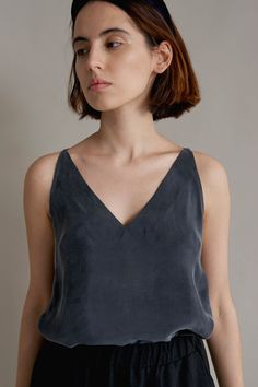 """A summer top in the form of the letter A , made of natural Cupro material, which is an ideal alternative to silk. The uneven color of the material and the noble, """"peach"""" finish of the material make the top also suited to more elegant parties. Unregulated straps made of the same material. Deep V-neck in a beautifully slims the figure."""