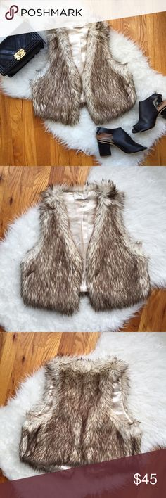 Brown/Tan Faux Fur Vest Stay warm and chic this season with this gorgeous faux fur vest! Love the coloring of the fur, and is the perfect length so gives such a flattering silhouette. Also is very well-made. Used only a handful of times so in great condition. Love it layered on a white long sleeve and jeans. Marked as a L but I'm a dress size 6 and it fits well. Enjoy! Jackets & Coats Vests