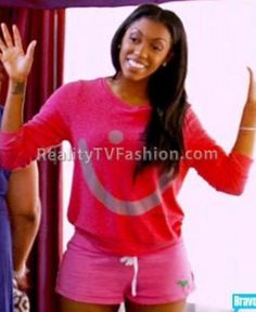"""Last night on """"Real Housewives of Atlanta""""Porsha Stewartrelaxed in her Vegas hotel room in the $98hot pink """"I Am Confidence"""" Sweaterfrom Peace Love World's Comfy KT Collection. The oversized b..."""