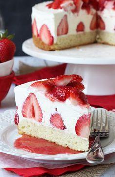Strawberry Shortcake Cheesecake - shortcake topped with strawberries, no bake vanilla cheesecake and whipped cream!