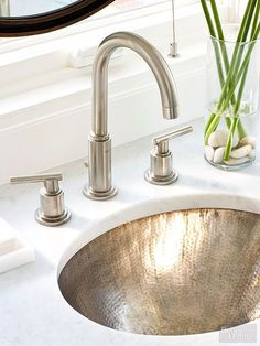 A hammered nickle bowl makes a statement against marble countertops on this sleek sink: http://www.bhg.com/bathroom/remodeling/planning/bath-details/?socsrc=bhgpin032815bowledover&page=9