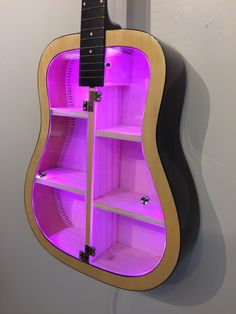 Guitar Shelf # Recycled acoustic guitar with color changing LED and 2 clear plexiglas doors.Wall hanging guitar with custom shelves Guitar Shelf Recycled acoustic guitar with color Cardboard Furniture, Funky Furniture, Furniture Design, Guitar Decorations, Guitar Shelf, Custom Shelving, Led Light Kits, Music Decor, Shabby Chic Bedrooms