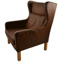Tan Brown Leather Danish Modern Lounge Chair | From a unique collection of antique and modern lounge chairs at https://www.1stdibs.com/furniture/seating/lounge-chairs/