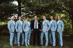 Summer groomsmen wedding attire idea - light gray suits + navy suit for groomsmen {Aster & Olive Photography}