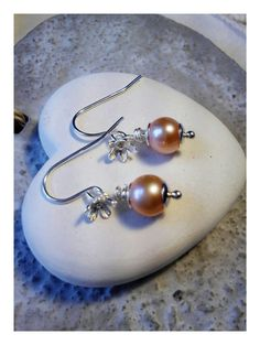 Check out this item in my Etsy shop https://www.etsy.com/uk/listing/232909704/peach-and-silver-pearl-earrings