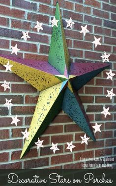We like this colorful metallic star on Maya and David's porch. Do you know the meaning behind these stars? We checked it out and learned quite a bit. Found at Front-Porch-Ideas-and-More.com