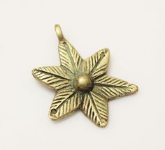 Hey, I found this really awesome Etsy listing at https://www.etsy.com/listing/210835966/african-flower-brass-pendant-lost-wax