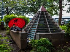 Homeless people are a part of Tokyo life -Asakusa's too. Here's one of them taking a nap in Sumidakoen Park, next to the river. Notice the Edo iki touch in the umbrella. #Asakusa, #Sumidakoen, #homeless, #umbrella September 6, 2015 © Grigoris A. Miliaresis