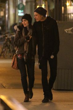 """Lily Collins and Jamie Campbell Bower are all smiles and affectionate while going for a late night walk in Toronto, Canada. After a long day of filming """"The Mortal Instruments: City of Bones"""" Lily Collins and Jamie Campbell Bower went for a walk to go get some ice cream at Yoco Frozen Yogurt in Toronto."""