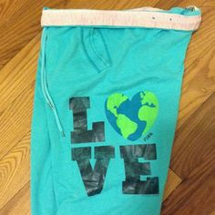 """PINK Victoria's Secret """"LOVE"""" sweats Size small. Pale turquoise. Black lettering and earth shaped heart. Fold over waistband is cotton material w/ white and baby pink stripes. Two side pockets with the cotton material, white and baby pink stripes. Flared bottoms. Drawstring closure. Body: 60% cotton and40% polyester. Trim: 100% cotton. Hardly worn and in excellent condition. Feel free to ask me any questions PINK Victoria's Secret Intimates & Sleepwear Pajamas"""