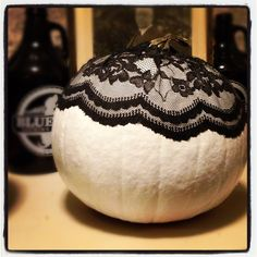 Lace Pumpkin:  (1) Spray paint white (covers much better than other types of paint)  (2) Cut out lace fabric to fit pumpkin  (3) Wrap pumpkin in lace  (4) Coat lace in Mod Podge and let dry
