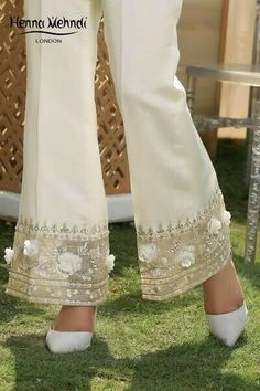 Ivory cotton silk trousers with embroidery and embellishment. Available to order as bootcut trousers, cigarette trousers, culottes or trousers. Please note embroidery pattern may vary. Formal Pants Women, Pants For Women, Clothes For Women, Pakistani Dress Design, Pakistani Dresses, Fashion Pants, Fashion Dresses, Salwar Pants, Embroidered Clothes