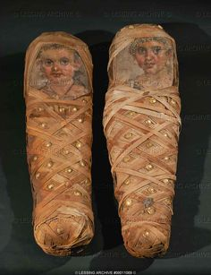 Two Fayum mummies of children, with portraits, Roman Egypt