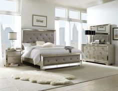 The Farrah Platform Bedroom Set from Pulaski Furniture exemplifies opulence and glamour. Featuring a multi-step metallic finish antique mirror borders add a touch of sparkle and silver drop- ring pulls complete the sophisticated and elegant look. Platinum fabric panels on the headboard and footboard are bejeweled with rhinestone buttons