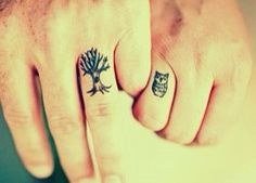 cute couple tattoos on the fingers of owl & tree