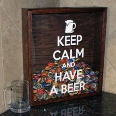 Cute idea for the basement bar. Shadowbox for bottle caps. Not for beer, but the general idea