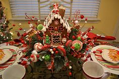 Gingerbread centerpiece Could really turn the boys gingerbread house into something spectacular.