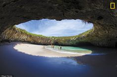 The small secluded beach ofPlaya del Amor, Marietas Islands in Mexico. Only six visitors can sun themselves on the beach at a time. It isencircled by an impressive rock ring forming a natural oculus for the sun and sky