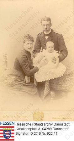 """Photo in 1889 by unknown photographer: Princess Irene (Irene Luise Maria Anna) (11 Jul 1866-11 Nov 1953) Hesse seated by her husband Prince Heinrich """"Henry"""" (Albert Wilhelm Heinrich) (14 Aug 1862-20 Apr 1929) Prussia-Germany who is also seated & holding their 1st child Waldemar (Waldemar Wilhelm Ludwig Friedrich Viktor Heinrich) (1889-1945) Prussia-Germany."""