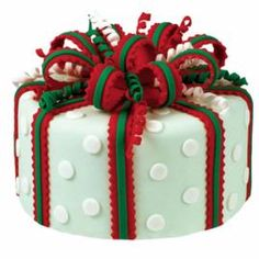 Holiday Happiness Cake - Holiday wrapping starts now! Add a festive touch to this cake with seasonal colors, fun cut outs, cute curlicues, and a magnificent ribbon striped bow. Watch our online video. Christmas Cake Designs, Christmas Cake Decorations, Christmas Sweets, Holiday Cakes, Christmas Goodies, Christmas Baking, Christmas Cakes, Xmas Cakes, Simple Christmas