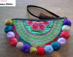 Handmade pom pom double sided embroidered small purse half moon shape semi circle shape multi colored pom poms has a tassle and wrist band  Please check measurements before you buy Size 12*22cm please allow error of 1cm-2cm Semi circle with a radius big enough for -a medium sized phone -lipstick -coins -keys Purse is not for big items Color you will see in real life can slightly differ from the color on the monitor