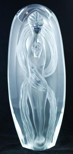 """Lalique French crystal """"Eroica"""" Vase. Signed M. Lalique and dated 1989. Catalog No. 12337. Includes original box. Measures 13 1/8"""" height (33.3cm). Conceived specifically for the bicentennial of the French Revolution, this work is a hymm to liberty. This design harmoniously unites transparent and satin-finished crystal. The slender body of a woman, holding the flame of triumphant liberty, is sculpted on the surface of the oblong shaped vase, Marie-Claude Lalique design 1989."""