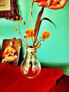 Hanging light bulb vase.