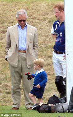 Charles is also said to have seldom seen grandson Prince George, pictured with Prince Harr...