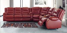 3 pc Vacherie salsa faux leather sectional sofa with recliner ends. This set includes the sofa and the love seat with recliners on the ends. Sectional measures x x x H. Single rocker recliner also available separately at additional cost Ashley Furniture Sofas, Cheap Furniture, Discount Furniture, Luxury Furniture, Furniture Outlet, Red Leather Sectional, Red Sofa, Sectional Sofa With Recliner, Reclining Sectional